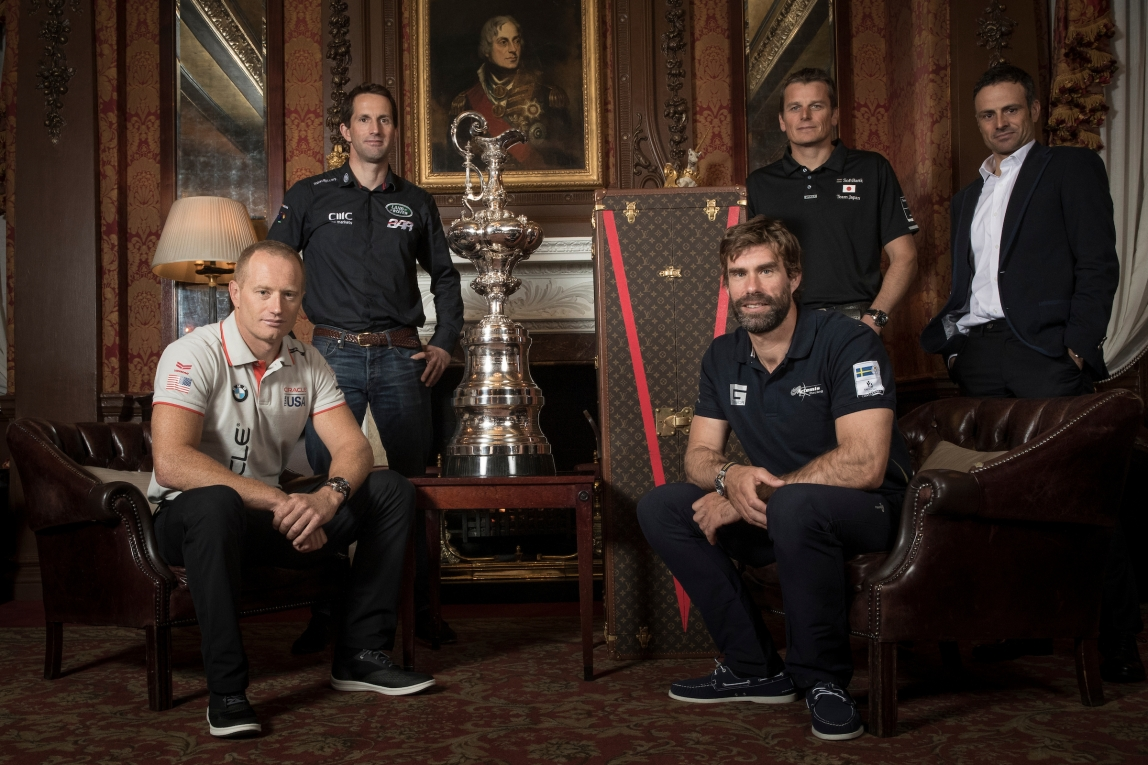 The Americas Cup 2017 - 2021 framework agreement press conference. Sir Ben Ainslie skipper of LandRover BAR, Franck Cammas skipper of Groupama Team France, Dean Barker skipper of SoftBank Team Japan, Iain Percy skipper of Artemis Racing and Jimmy Spithill skipper of Oracle Team USA. Shown here with the Americas Cup in London prior to the framework announcement. Photo by Lloyd Images/ACEA